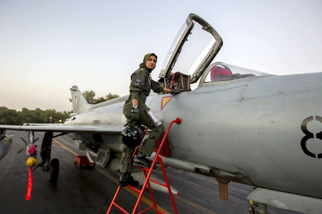 Ayesha Farooq, 26, Pakistan's only female war-ready fighter pilot, climbs up to a Chinese-made F-7PG fighter jet at Mushaf base in Sargodha, north Pakistan June 6, 2013. (Photo by Zohra Bensemra/Reuters)