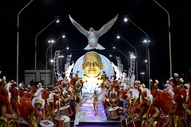 The Ara Yevi samba school performs on a float showcasing Pope Francis during carnival in Gualeguaychu, Argentina, early Sunday, January 11, 2015. Members of the samba school said the Pope doesn't know they chose to honor his life at this year's celebration and look forward for him seeing their performing. (Photo by Natacha Pisarenko/AP Photo)