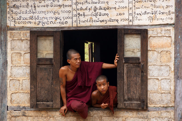 """""""Buddhist monks"""". At the hills around Kalaw (Myanmar) there are a number of villages that are accessible only by foot. Daily several small groups of tourists visit these villages. These two monks were looking at the tourists who just entered the Palaung village. (Photo and caption by Paul Klaassen/National Geographic Traveler Photo Contest)"""