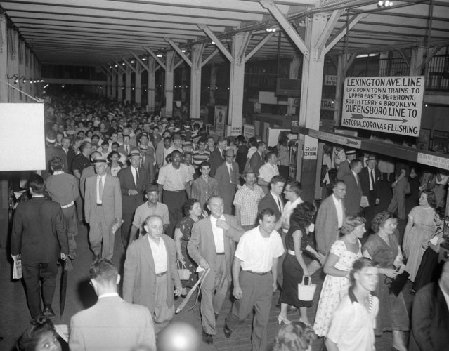 Crowds of homebound New Yorkers move slowly toward the Grand Central station of the IRT's Lexington Avenue line after leaving the crosstown shuttle during the peak of the rush hour, July 16, 1956. (Photo by Tom Fitzsimmons/AP Photo)