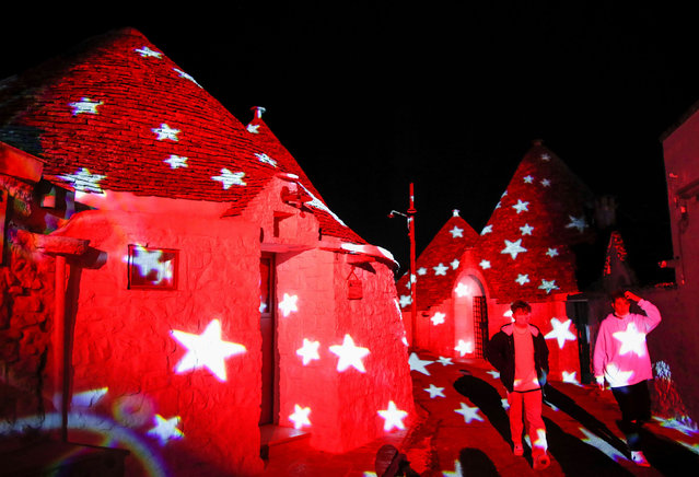 The famous trulli, or limestone, buildings of Alberobello, a World Heritage Site, are lit up with Christmas animations, as Italy goes back to a complete lockdown during Christmas season as part of efforts put in place to curb the spread of the coronavirus disease (COVID-19), in Alberobello, Italy, December 23, 2020. (Photo by Alessandro Garofalo/Reuters)