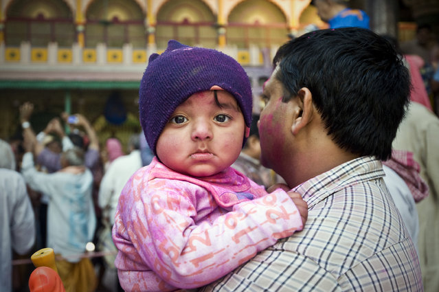 """The Toddler"". When I was taking photos of the people celebrating Holi Festival, I noticed this toddler was looking at me for a while. Location: Mathura, India. (Photo and caption by Ng Hock How/National Geographic Traveler Photo Contest)"