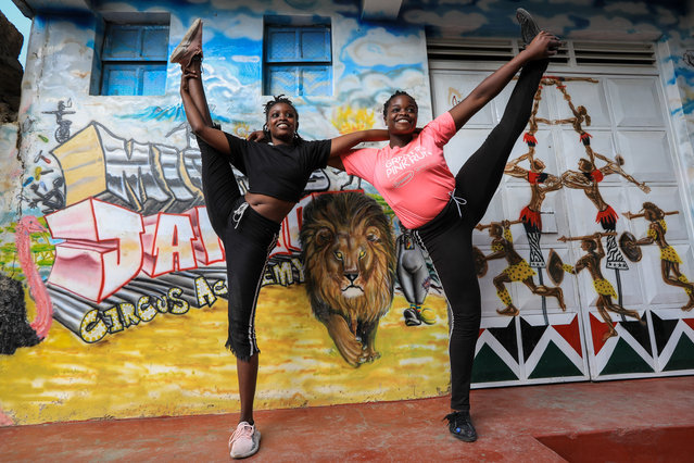 Kenyan acrobatic members of the Mighty Jambo Circus Academy pose for a photo at the entrance after their training routine at the academy in Nairobi, Kenya, 13 January 2021. (Photo by Daniel Irungu/EPA/EFE)