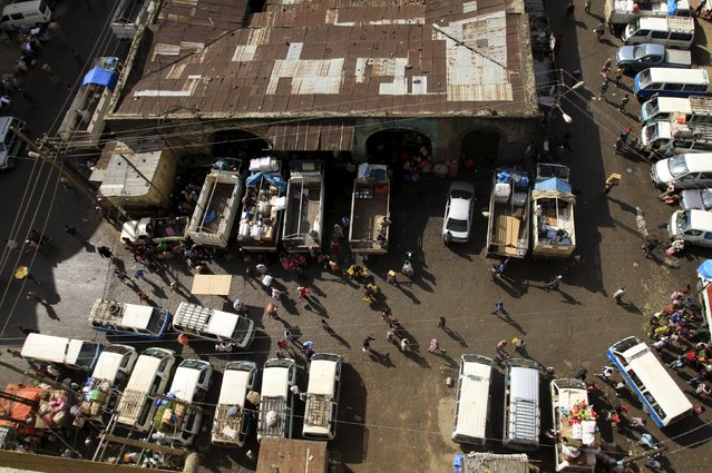 Trucks and commericial vehicles are unloaded at the Mercato market in Addis Ababa September 11, 2015. (Photo by Tiksa Negeri/Reuters)