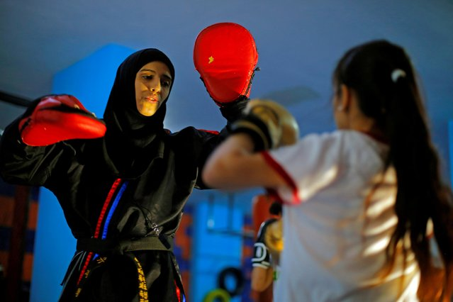 Martial arts trainer Seham Amer practices self-defense moves with a trainee at a training center in Sanaa, Yemen on September 1, 2020. (Photo by Nusaibah Almuaalemi/Reuters)