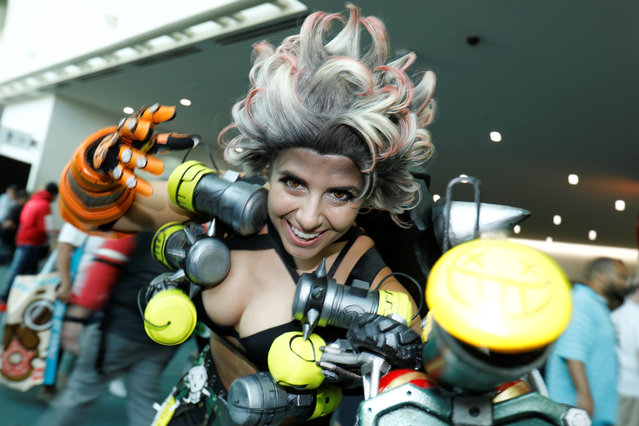 An attendee dressed as Junkrat from the game Overwatch poses for a picture during opening day of pop culture convention Comic Con International in San Diego, USA on Thursday, July 19, 2018. (Photo by Mike Blake/Reuters)