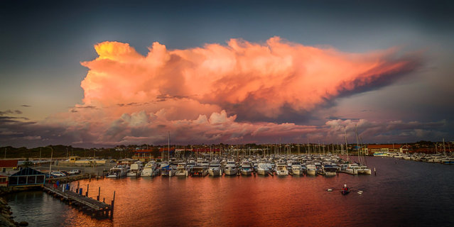 Stormy clouds over Perth Harbor in Australia. (Photo by Oliver Kay/Caters News)