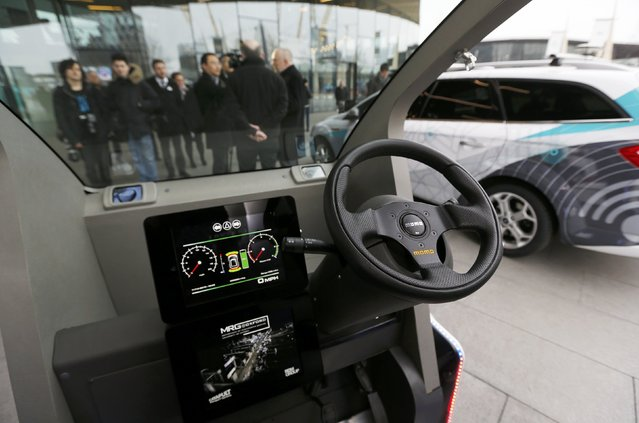 A prototype of a Lutz Pathfinder driverless vehicle is displayed to members of the media in Greenwich, east London, February 11, 2015. The Pathfinder will become the first vehicle of its kind to be used in a community setting and will soon begin testing using a footpath in Milton Keynes in central England. (Photo by Suzanne Plunkett/Reuters)