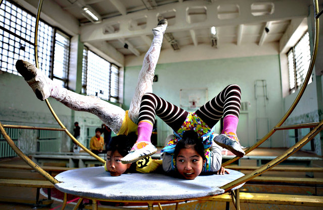 Members of Shonkhoodoi Circus practise in a gymnasium in Darkhan August 23, 2013. Mission Manduhai is created by Chimgee Haltarhuu, a former Mongolian gymnast and victim of domestic abuse, who brought three U.S. students and six young performers from Shonkhoodoi Circus in Darkhan to travel through the Mongolian countryside to give free circus performances. The free performances are held as a way to raise awareness on domestic abuse, by distributing leaflets on domestic abuse before and after the shows. (Photo by Mareike Guensche/Reuters)