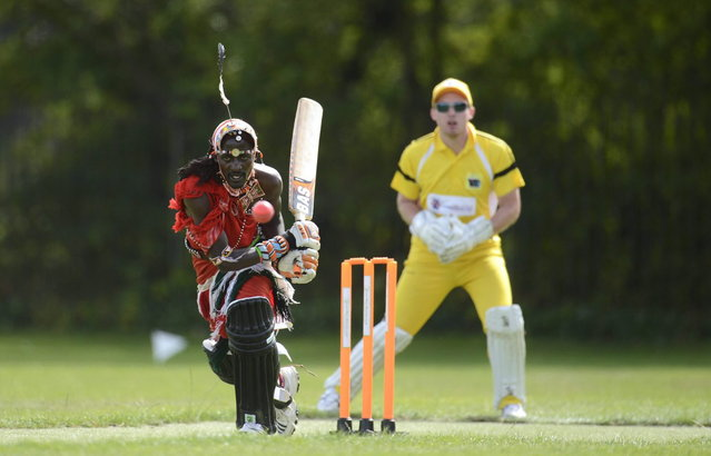 "Nissan Jonathan Ole Meshami (L) of the Maasai Cricket Warriors team from Kenya hits the ball during a match against English team ""The Shed"", during the ""Last Man Stands"" cricket tournament at Dulwich sports ground in South London September 1, 2013. (Photo by Philip Brown/Reuters)"