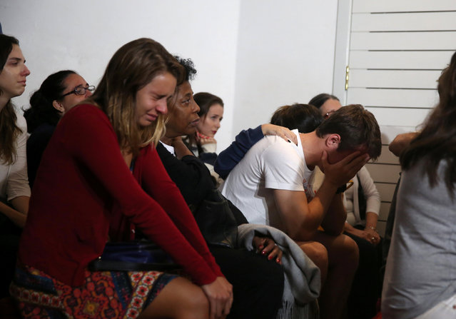 Relatives of Brazilian journalist Guilherme Marques, who died in a plane accident that crashed into Colombian jungle with Brazilian soccer team Chapecoense onboard near Medellin, mourn during a mass in Rio de Janeiro, Brazil, November 29, 2016. (Photo by Pilar Olivares/Reuters)