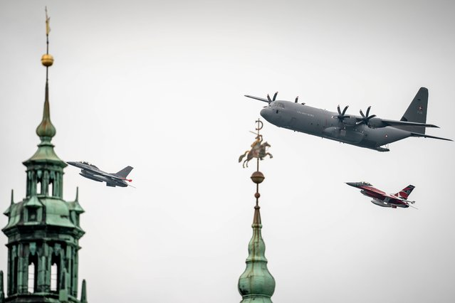 A Hercules C-130 (top) and a F-16 fighter jet of the Royal Danish Air Force fly past Kronborg Castle in Helsingor, Denmark on October 1, 2020. On the occasion of the 70th anniversary of its foundation, the Royal Danish Air Force on October 1 holds an exercise with helicopters, transport aircraft and fighter jets flying over most of the country. (Photo by Mads Claus Rasmussen/Ritzau Scanpix/AFP Photo)