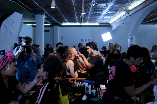 Model Madeline Stuart, who has Down's syndrome, is prepared backstage before walking in the Lulu Et Gigi presentation at New York Fashion Week in New York City, U.S., September 9, 2018. (Photo by Andrew Kelly/Reuters)