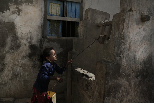 In this February 12, 2018, file photo, a girl pulls water from a well in the home of Ahmed al-Kawkabani, leader of the southern resistance unit in Hodeida, in al-Khoukha, Yemen. (Photo by Nariman El-Mofty/AP Photo)