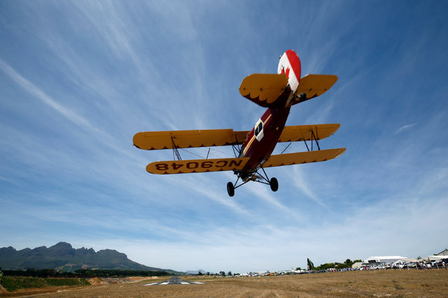 A biplane taking part in the Vintage Air Rally lands, in Stellenbosch, near Cape Town, South Africa December 16, 2016. (Photo by Mike Hutchings/Reuters)