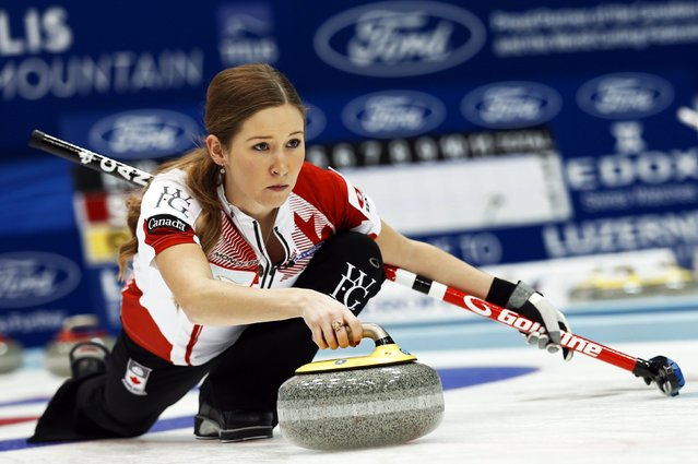 Canada's third Kaitlyn Lawes delivers a stone during her curling round robin game against Scotland at the World Women's Curling Championships in Sapporo March 15, 2015. (Photo by Thomas Peter/Reuters)