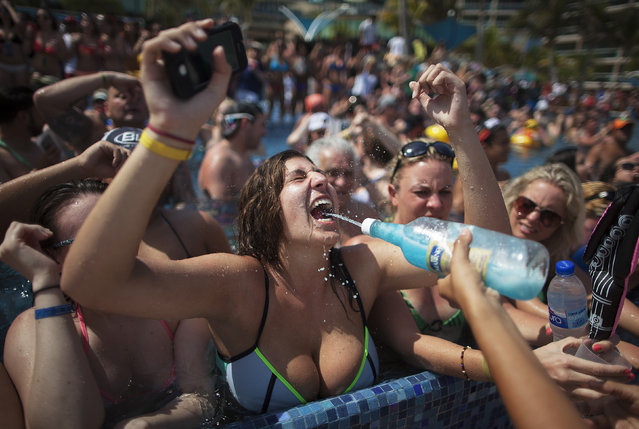 A spring breaker takes a shot of tequila during a pool party at a hotel in Cancun March 8, 2015. (Photo by Victor Ruiz Garcia/Reuters)