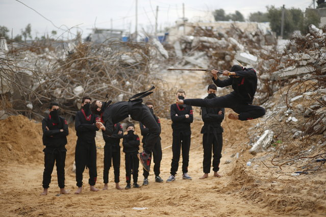 Palestinian youths jump as they demonstrate their ninja-style skills for a photographer in front of the ruins of buildings, that were destroyed in the 2014 war, in the northern Gaza Strip January 29, 2016. (Photo by Mohammed Salem/Reuters)