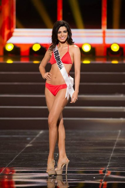 A handout picture provided by the Miss Universe Organization shows Lucia Aldana, Miss Colombia 2013, competing in the swimsuit competition during the Preliminary Competition at the Crocus City Hall, in Moscow, Russia, 05 November 2013. (Photo by Darren Decker/EPA)