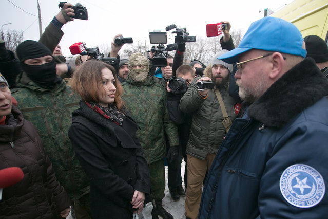 Recently freed judge Anzhelika Presnyakova (L) and journalist Olga Svorak (C) talk with negotiator Volodymyr Ruban who was involved in prisoner swaps (R) during a gathering in Donetsk on December 27, 2016. Ukraine' s pro- Moscow insurgents released two women they had held captive thanks to the intervention of Nadya Savchenko – a Kiev- born female combat pilot who spent nearly two years in a Russian jail. The freeing of the women – a judge and a journalist – came after Savchenko, now a member of parliament, held a private meeting with the heads of the separatist regions of Lugansk and Donetsk earlier this month. (Photo by Mikhail Sokolov/TASS)