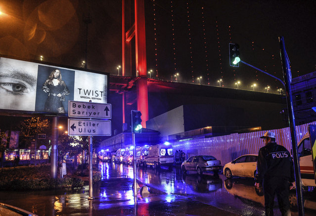 Ambulances rush on the scene of an attack in Istanbul, early Sunday, January 1, 2017. (Photo by AP Photo)