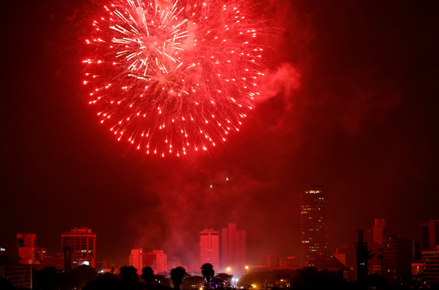 Fireworks explode over the Kenyatta International Convention Centre (KICC) square during the New Year's Eve celebrations in Nairobi, Kenya, January 1, 2017. (Photo by Thomas Mukoya/Reuters)