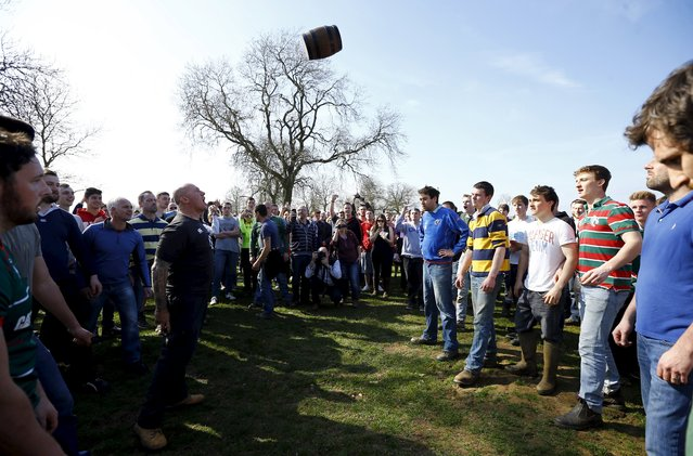 Players wait for the bottle to hit the ground to start the bottle-kicking game in Hallaton, central England April 6, 2015. (Photo by Darren Staples/Reuters)