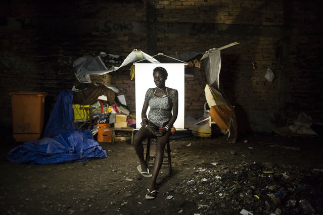"In this March 18, 2015 photo, Patricia Sebastiao, 22, poses for a portrait in an open-air crack cocaine market, known as a ""cracolandia"" or crackland, where users can buy crack, and smoke it in plain sight, day or night, in Rio de Janeiro, Brazil. Patricia, who has a 2-year-old daughter and 1-year-old son, is pregnant with her third child. She said she is 6 or 7 months pregnant, but was not exactly sure. (Photo by Felipe Dana/AP Photo)"