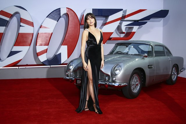 """Cuban-Spanish actress Ana de Armas poses for photographers upon arrival for the World premiere of the new film from the James Bond franchise """"No Time To Die"""", in London Tuesday, Sept. 28, 2021. (Photo by Joel C Ryan/Invision/AP Photo)"""