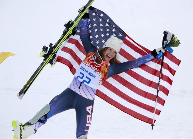 Women's supercombined bronze medalist United States' Julia Mancuso poses with the U.S. flag after a flower ceremony at the Alpine ski venue in the Sochi 2014 Winter Olympics, Monday, February 10, 2014, in Krasnaya Polyana, Russia. (Photo by Gero Breloer/AP Photo)