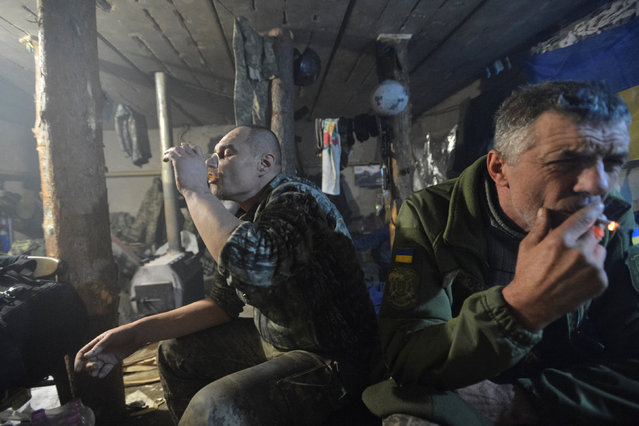 Ukrainian servicemen rest at their position on the front line near the government-held town of Avdiyivka, Ukraine, February 8, 2017. (Photo by Oleksandr Klymenko/Reuters)