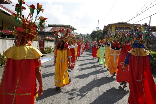"""Penitents known locally as """"Morions"""" parade during the start of Holy Week celebrations in Mogpog, Marinduque in central Philippines March 21, 2016. (Photo by Erik De Castro/Reuters)"""
