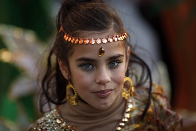 A girl wearing a costume takes part in a parade during the carnival of Malaga, southern Spain, on February 23, 2014. (Photo by Jon Nazca/Reuters)