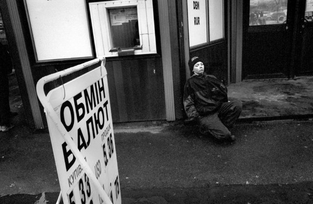 Coming down from his high, Sasha starts to realize that he did not receive any money and he is also out of glue, 2002. Because it is harder for boys to receive money from begging the girls are forced to beg or prostitute in order to support the group. (Photo by Kurt Vinion /Getty Images)