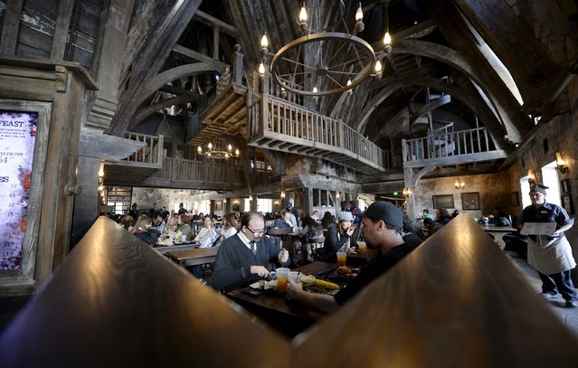 """Guests eat lunch inside Three Broomsticks, an aged rustic tavern, in Hogsmeade Village during a soft opening and media tour of """"The Wizarding World of Harry Potter"""" theme park at the Universal Studios Hollywood in Los Angeles, California in this picture taken March 22, 2016. (Photo by Kevork Djansezian/Reuters)"""