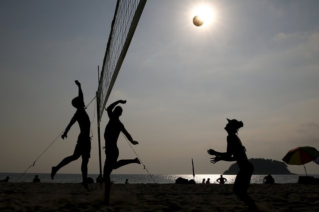Tourists play volleyball on Kata beach in Phuket, Thailand March 17, 2016. (Photo by Athit Perawongmetha/Reuters)