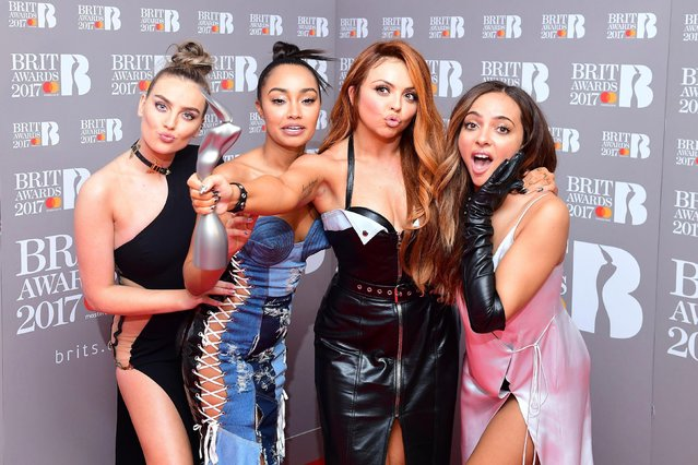 (L-R) Perrie Edwards, Leigh-Anne Pinnock, Jesy Nelson and Jade Thirlwall of Little Mix pose with their award for Best British Single in the winner's room at The BRIT Awards 2017 at The O2 Arena on February 22, 2017 in London, England. (Photo by PA Wire)