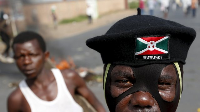 A masked protester stands during a protest against Burundi President Pierre Nkurunziza and his bid for a third term in Bujumbura, Burundi, May 21, 2015. (Photo by Goran Tomasevic/Reuters)