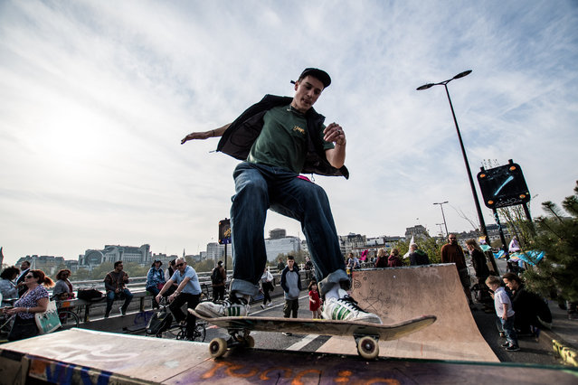 A man skating on a halfpipe on Waterloo Bridge as part of the Extinction Rebellion protests in London, England on April 19, 2019. (Photo by Brais G. Rouco/The Guardian)