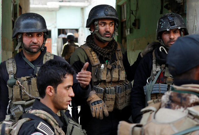 Iraqi special forces soldiers stand in a house during a battle with Islamic State militants in Mosul, Iraq March 1, 2017. (Photo by Goran Tomasevic/Reuters)