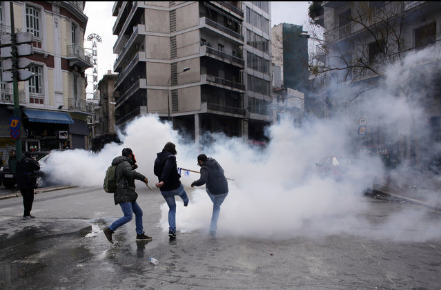 Farmers clash with riot policemen during a protest outside the Greek Agriculture Ministry on March 8, 2017 in Athens, Greece. Farmers protested against the government's tax and pension system reforms. Clashes broke out with riot police using teargas to repel the protesters. (Photo by Milos Bicanski/Getty Images)