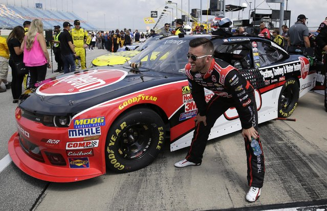 Austin Dillon (33) looks to the track  before the NASCAR Xfinity series auto race at Chicagoland Speedway, Sunday, June 21, 2015, in Joliet, Ill. (AP Photo/Nam Y. Huh)