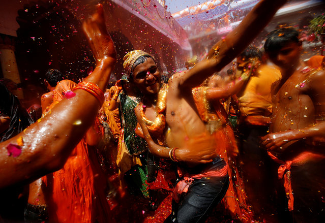 """Hindu devotees dance during """"Huranga"""", a game played between men and women a day after Holi, at Dauji temple near Mathura, March 14, 2017. (Photo by Adnan Abidi/Reuters)"""