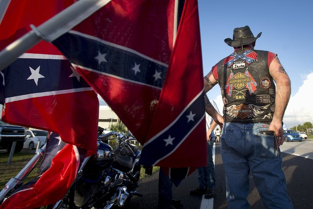 "A biker stands beside his motorcycle as he waits for other participants to catch up during a ""Ride for Pride"" event to show support for the Confederate flag in Brandon, Hillsborough County, June 26, 2015. (Photo by Carlo Allegri/Reuters)"
