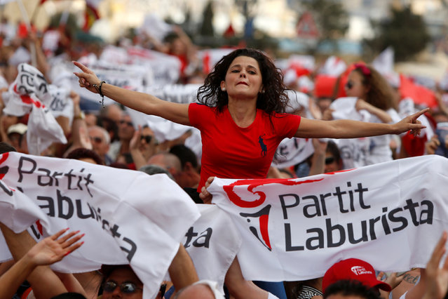 Labour Party supporters celebrate before the arrival of Prime Minister and party leader Joseph Muscat at a May Day rally organised by the party in Valletta, Malta, May 1, 2016. (Photo by Darrin Zammit Lupi/Reuters)