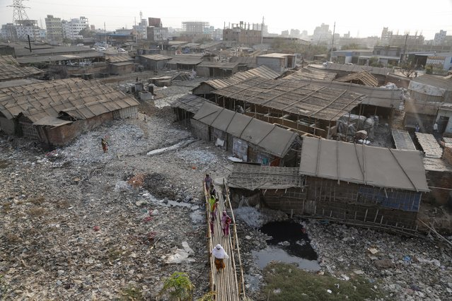 In this Monday, February 6, 2017 photo, a view of the highly polluted Hazaribagh tannery area is seen in Dhaka, Bangladesh. Pure Earth a nongovernmental organization that addresses industrial pollution put Hazaribagh on its Top 10 list of polluted places, along with Chernobyl, although similar problems of pollution and dangerous working conditions exist at tannery clusters in the Philippines and India as well. (Photo by A.M. Ahad/AP Photo)