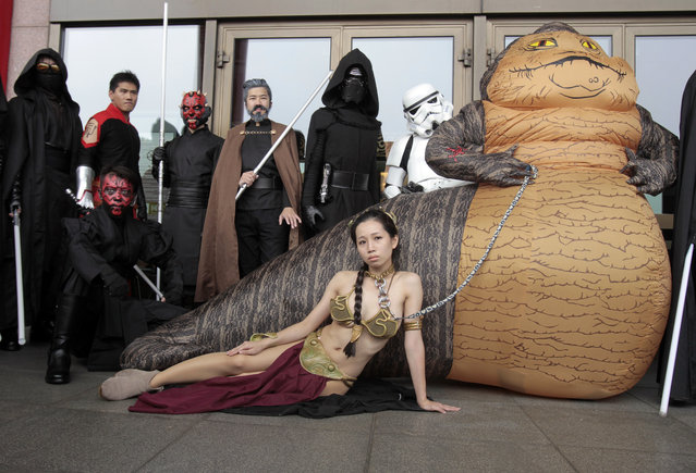 "Fans dressed as movie Star Wars characters pose as they cerebrate the Star Wars Day in Taipei, Taiwan, Wednesday, May 4, 2016. May 4 is known as Star Wars Day among fans worldwide since the date sounds phonetically similar to the franchise's slogan, ""May the Force Be With You"". (Photo by Chiang Ying-ying/AP Photo)"