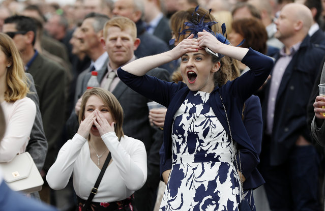 Racegoers watch the 1.40 Alder Hey Children's Charity Handicap Hurdle during the Grand National Festival at Aintree Racecourse on April 6, 2017 in Liverpool, England. (Photo by Darren Staples/Reuters/Livepic)
