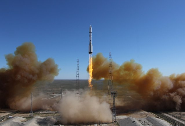 A Russian-built Proton rocket with Russian relay satellite Luch-5V and the Kazakh communication satellite KazSat-3 aboard blasts of from a launch pad in the Russian leased Kazakhstan's Baikonur cosmodrome on April 28, 2014. (Photo by AFP Photo/Stringer)