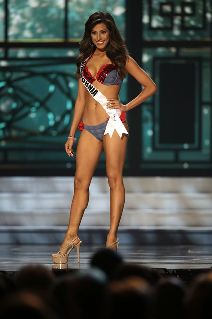 Miss California, Natasha Martinez, competes in the swimsuit competition during the preliminary round of the 2015 Miss USA Pageant in Baton Rouge, La., Wednesday, July 8, 2015. (Photo by Gerald Herbert/AP Photo)